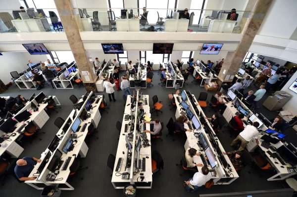 Journalists work in the main newsroom area of the new Al Jazeera America television broadcast studio on West 34th Street August 16, 2013 in New York. Al Jazeera America, which will launch on August 20, will have its headquarters in New York. AFP PHOTO/Stan HONDA
